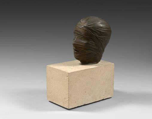 Igor Mitoraj, visage bandé, sculpture
